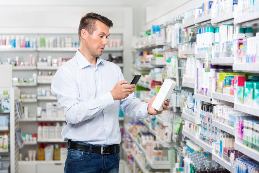 guy looking at medication.jpg